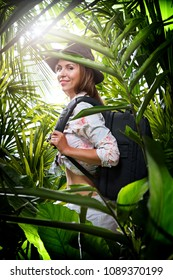 portrait of nice young woman  exploring jungle environment