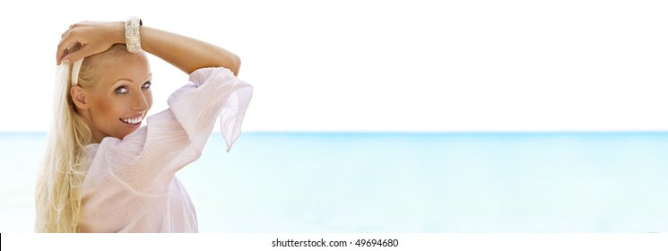 Portrait of nice young woman having good time on the beach. Banner, lots of copy space