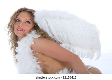 portrait of the nude blonde-angel with blue eyes on white