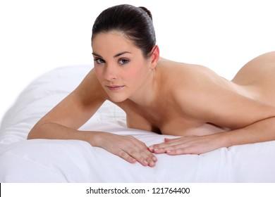 Portrait of a nude woman lying on a mattress
