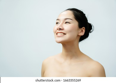 Portrait nude young Asian woman Close up of beautiful faces Feel Happy. Smile with a healthy white teeth. Good body skin. isolated on white background for beauty and skin care concepts