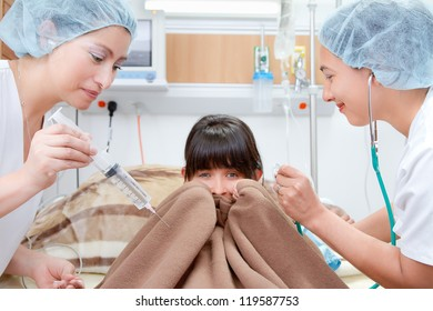 portrait of nurses and scared patient at hospital in the bed holding sheets