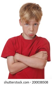 Portrait of an offended young boy on white background