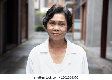 portrait of old Asian senior woman with wrinkle skin and black dyed hair
