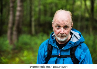 A portrait of an old crazy Swedish man in a forest, Sweden, Scandinavia
