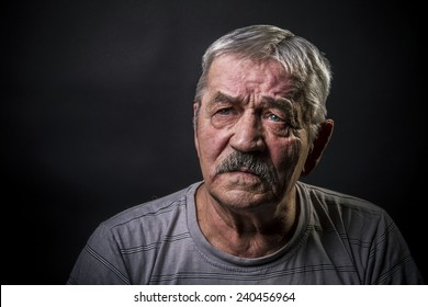 portrait of an old gray-haired man with a mustache