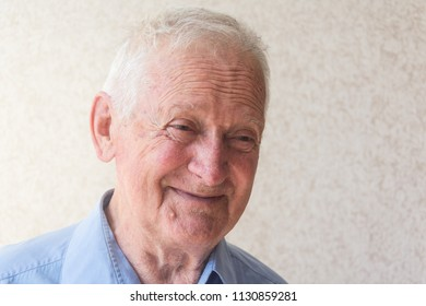 Portrait of a old happy - joyful and smile business man.