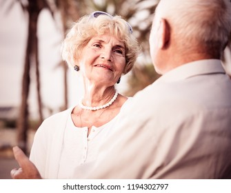 Portrait of old happy male and female talking on the nature