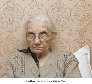 Portrait of old lady (European) with glasses.