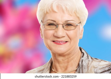 Portrait of an old lady in eyeglasses.