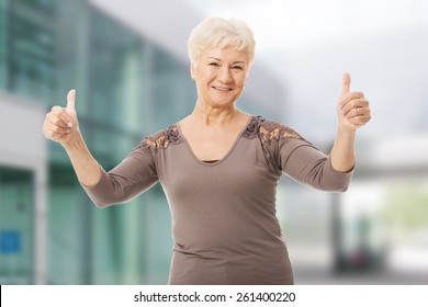 Portrait of an old lady showing OK