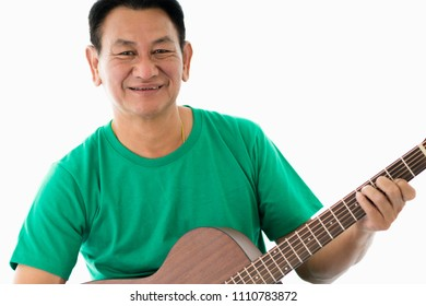 Portrait of old man with acoustic guitar with happiness retirement on white background.