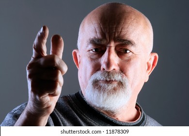 a portrait of a old man with angry face