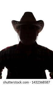 Portrait of a old man, in a cowboy hat, with beard, front view - dark isolated silhouette