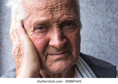 Portrait of an old man eighty years.