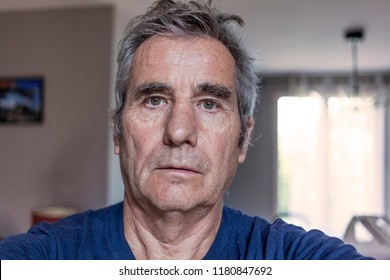 portrait of old man at home