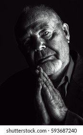 Portrait of old man over black background. Old age concept.