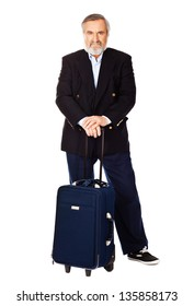Portrait of an old man standing with luggage bag on white background