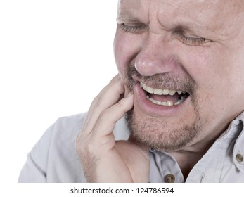 Portrait of old man suffering from toothache