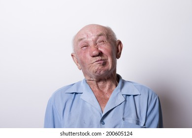 Portrait of an old man with a toothache