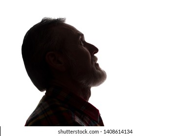 Portrait of a old man, unshaven, with beard, side view - dark isolated silhouette