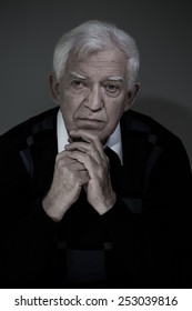 Portrait of an old man, vertical photo