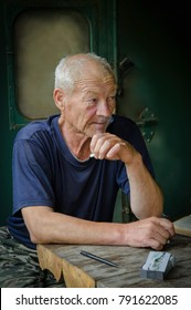 Portrait of an old man, a veteran of the North Russian Far East, leading a story about the history of the development of the region