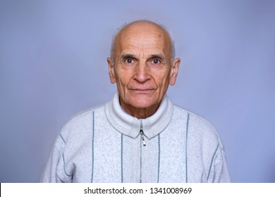 portrait of an old man in a warm white sweater