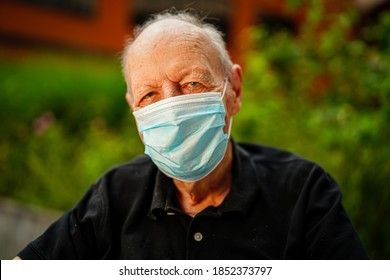 Portrait of old man wearing a face mask during Covid-19 pandemic