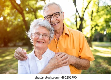 Portrait of old senior couple in love at the park