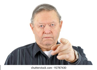 Portrait of old senior man pointing at camera looking angry.