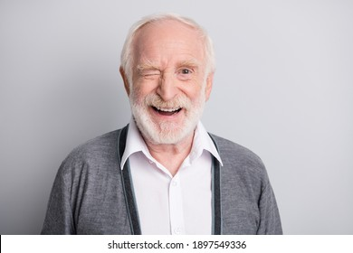 Portrait of old white hair optimistic man blink wear dark sweater isolated on grey background