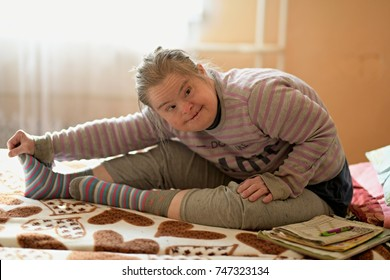 portrait of old woman with down syndrome