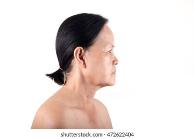 Portrait of the old woman facing side isolated on white screen, Wrinkle on face old woman