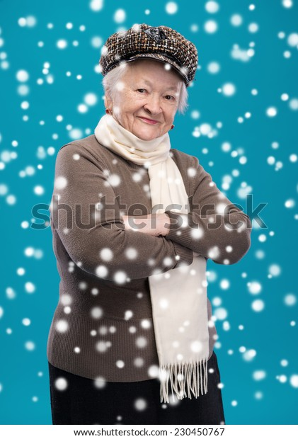 Portrait of old woman in hat. Christmas and holidays concept
