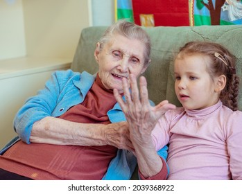 Portrait of an old woman and a little girl, grandmother hugs her granddaughter, family ties, old age and youth, 90 years, wrinkles on an old face, beautiful old age, a woman and a child.