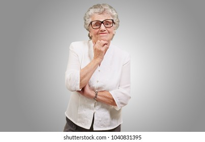 Portrait Of Old Woman On Gray Background