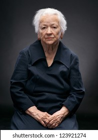 Portrait of old woman on a gray background