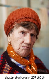Portrait of old woman in red beret