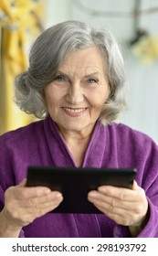 Portrait of  Old woman  with tablet pc