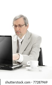 Portrait of an older businessman with a computer and a cup. Isolated white background.