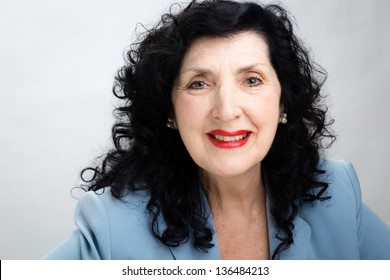 Portrait of an Older Businesswoman Smiling Directly to the Camera