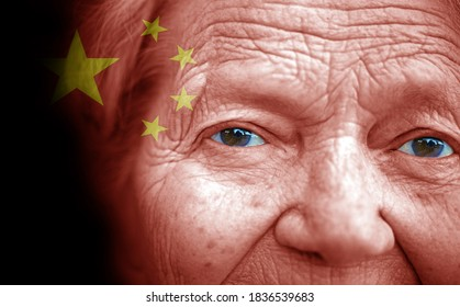 Portrait of older lady with painted national flag of China