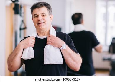 Portrait of older man at the gym