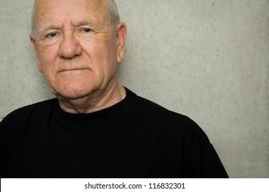 Portrait of an older man wearing black t-shirt