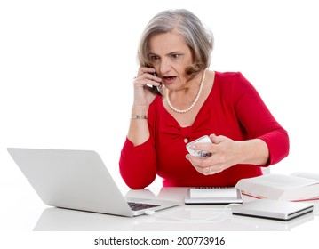 Portrait of an older nervous excited and worried senior business woman isolated.