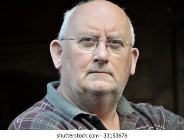 portrait of an older unshaven male