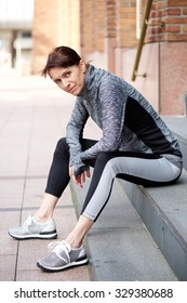 Portrait of an older woman resting outside after workout