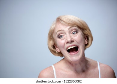 portrait on beautiful mature woman closeup face skin isolated on blue background