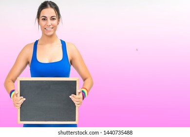 portrait on white isolated background pink of a beautiful young sportswoman with space for advertising -copy space image